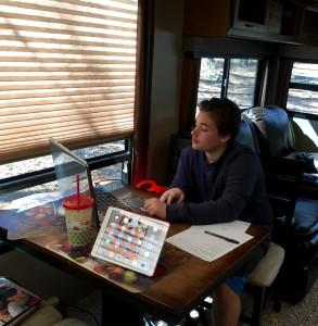 Elijah doing his Pre-Algebra on the computer. We LOVE Teaching Textbooks!