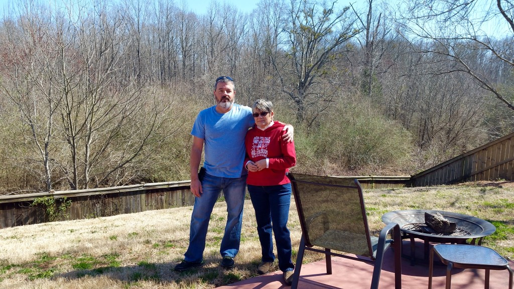 Greg and I in our beautiful backyard overlooking the nature preserve. I don't look too happy in this picture, do I? THIS is what I will miss the most about our old house. That said, now our backyard will change regularly and I can't wait.