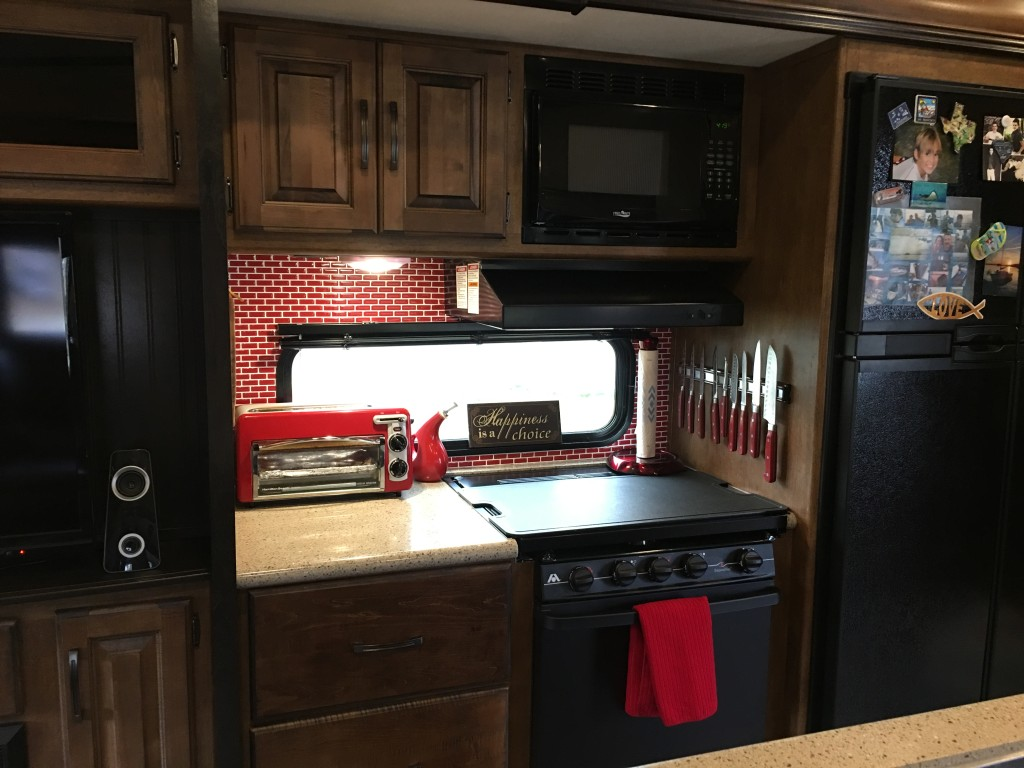 I just installed these red smart tiles (actually they are a knock off brand) today! It took me much longer to get them up than I anticipated, but the were worth the effort. I LOVE them! See the magnetic knife holder?!?! It's amazing and the knives do not budge during transport. Not to mention, I've always wanted one.