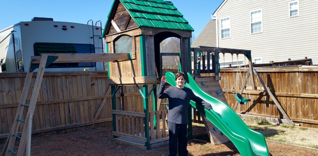 We have lived in this house since Elijah was 4, so it's all he remembers! Here is his final picture with his childhood play set. (He hasn't played on it for years! LOL)